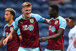 Burnley's Dan Agyei (right) celebrates scoring his side's first goal of the game with Burnley's Jimmy Dunne during a pre season friendly match at Deepdale, Preston.