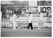 England captain Mike Gatting closes on umpire Shakoor Rana during the 2nd Test Match, Pakistan v England at the Iqbal Stadium Faisalabad, 8.12.1987. Photograph: Graham Morris/cricketpix.com (Tel: +44 (0)20 8969 4192; Email: sales@cricketpix.com) Ref. No. 87663b12