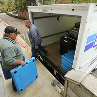 Ray Bailey and Lee Kimble, employees with Lee County, load up voting machines and tables onto their truck for District 5 on Monday morning at the Lee County Justice Center in Tupelo.