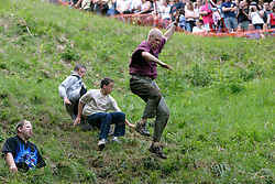 UK ENGLAND COOPERS HILL 31MAY04 - Contestants throw themselves down a steep 200-metre slope in pursuit of a 7-pound Cloucester Cheese. The cheese rolling is one of the oldest customs to have survived some saying, for hundreds of years, even pre-Roman times. The ceremony is reported to.have taken place originally at midsummer and to have been moved to Whitsun in early Saxon times. Some say it is a relic of an old heathen festival to celebrate the return of spring and.others say, when held in midsummer, it represented the waning of the sun as summer reached its height, but no one knows for sure....jre/Photo by Jiri Rezac..© Jiri Rezac 2004..Contact: +44 (0) 7050 110 417.Mobile:  +44 (0) 7801 337 683.Office:  +44 (0) 20 8968 9635..Email:   jiri@jirirezac.com.Web:     www.jirirezac.com