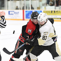 TRENTON, ON - Apr 22, 2016 -  Ontario Junior Hockey League game action between the against the Trenton Golden Hawks and the Georgetown Raiders. Game 5 of the Buckland Cup Championship Series, at the Duncan Memorial Gardens in Trenton, Ontario. Arran MacDonald #7 of the Georgetown Raiders battles for the puck with Curtis Harvey #93 of the Trenton Golden Hawks during the first period.<br /> (Photo by Andy Corneau / OJHL Images)