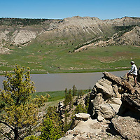 hikers along a knife edged ridge, enjoying their view of the wild and senic missouri river in the umrbnm, russel country, montana, usa, upper missouri river breaks national monument, russell