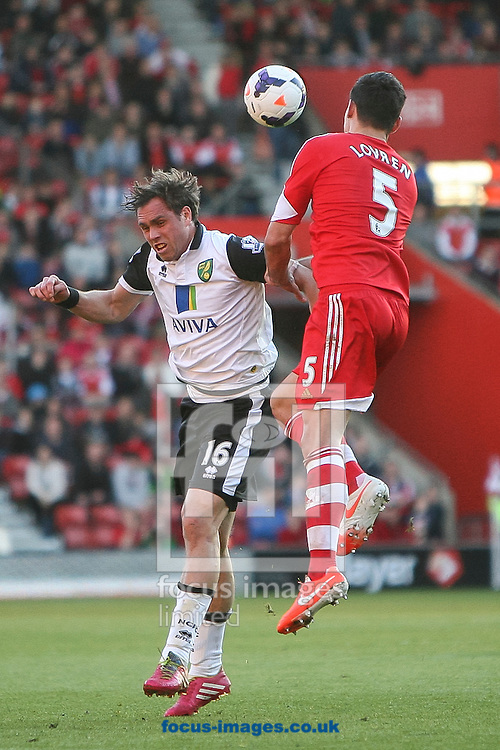 Johan Elmander of Norwich City and Dejan Lovren of Southampton compete for the ball during the Barclays Premier League match at the St Mary's Stadium, Southampton<br /> Picture by Daniel Chesterton/Focus Images Ltd +44 7966 018899<br /> 15/03/2014