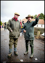 UKIP Leader Nigel Farage talks to a member of the public about that floods in  Burrowbridge, Somerset, United Kingdom. Sunday, 9th February 2014. Somerset has been flooded since the start of 2014, with people being forced to leave their homes. Picture by Andrew Parsons / i-Images