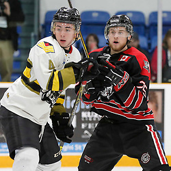 TRENTON, ON  - MAY 5,  2017: Canadian Junior Hockey League, Central Canadian Jr. &quot;A&quot; Championship. The Dudley Hewitt Cup. Game 7 between The Georgetown Raiders and The Powassan Voodoos. Cameron Moore #4 of the Powassan Voodoos and Jordan Anderson #25 of the Georgetown Raiders battle during the second period <br /> (Photo by Amy Deroche / OJHL Images)