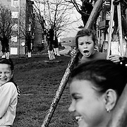 Children play in a housing estate in the heart of the small Romanian town of  Copsa Mica, Transylvania, Romania. Copsa Mica was once described as the most polluted town in Europe. May 9, 2008. Photo Tim Clayton....Copsa Mica, a small industrial town deep in Transylvania, Romania, was described during the 1990s as the most polluted town in Europe with lead levels reaching were more than 1000 times the allowable International limits and life expectancy nine years shorter than the National average...The pollution was caused entirely by two factories, Carbosin produced black for dies and tires and closed in 1993 while Sometra, a nonferrous smelter is still operational today...The pollution was so bad sheep were black, covered in soot and health officials advised against eating livestock or vegetables and drinking the water or milk...The Communist rule of Nicolae Ceausescu is blamed for the widespread environmental degradation that left industrial parts of Romania in ecological disaster. Industry was situated in a way to concentrate pollution in small areas leaving the rest of the country relatively free of pollution. Copsa Mica in particular was left an environmental disaster...The pollution caused a direct affect on human health with widespread Lung disease, Impotency, the highest infant mortality rate in Europe, Lead poisoning and behavioral problems...Fifteen years on since the closure of Carbosin in 1993, the factory skeleton remains as part of the towns bleak landscape, Unfinished communist style housing blocks still stand in the heart of the towns housing estate. The town's inhabitants are still trying to recover from the long lasting effects of pollution...Recent survey's found the soil contained so much lead that it was 92 times above the permitted level; the vegetation had a lead content 22 times above the permitted level. While toxins have penetrated at least one meter (three feet) into the soil leaving the entire food chain in the area conta
