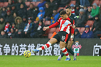 Football - 2019 / 2020 Premier League - Southampton vs. Burnley<br /> <br /> Dwight McNeil of Burnley pulls back Southampton's Che Adams during the Premier League match at St Mary's Stadium Southampton <br /> <br /> COLORSPORT/SHAUN BOGGUST