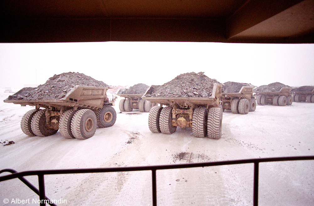 CAT 797B trucks lined up and loaded