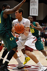 January 27, 2011; Stanford, CA, USA;  Stanford Cardinal forward Dwight Powell (33) is defended by Oregon Ducks forward Joevan Catron (left) during the second half at Maples Pavilion.  Oregon defeated Stanford 67-59.
