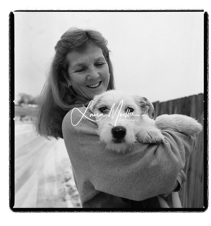2/19/03 Joann Hager, founder of Tri-County Animal Rescue, holds Scruffy, an 8 month old terrier mix. Hager and her husband Doug, both Duke Energy employees, began the non-profit animal shelter five years ago. It is now home to 150-175 dogs, cats and some other animals as they wait to be placed in loving homes. L.MUELLER/staff photo