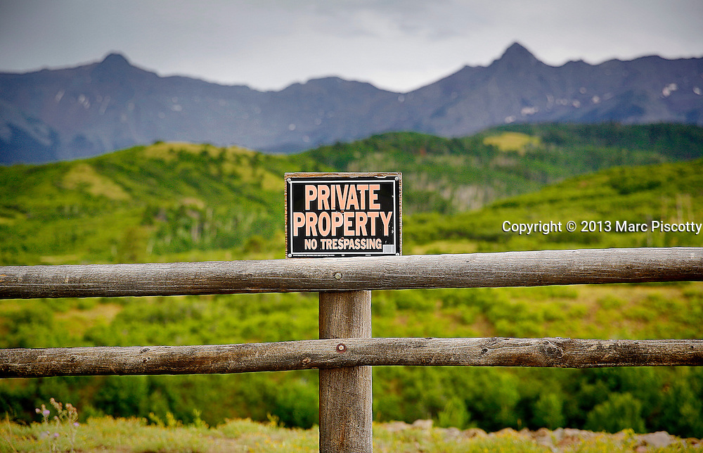 SHOT 7/18/13 4:44:02 PM - A private property sign with the San Juan Mountains in the background just outside of Ridgeway, Colorado. The San Juan Mountains are a high and rugged mountain range in the Rocky Mountains in southwestern Colorado. The area is highly mineralized (the Colorado Mineral Belt) and figured in the gold and silver mining industry of early Colorado. (Photo by Marc Piscotty / © 2013)