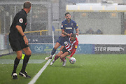 Lincoln City midfielder Jorge Grant (18) fouling AFC Wimbledon midfielder Anthony Wordsworth (40) during the EFL Sky Bet League 1 match between AFC Wimbledon and Lincoln City at the Cherry Red Records Stadium, Kingston, England on 2 November 2019.