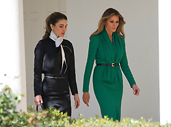 Queen Rania of Jordan, left, and first lady Melania Trump, right, walk along the Colonnade of the White House in Washington, DC on Wednesday, April 5, 2017. <br /> Credit: Ron Sachs / Pool via CNP *** Please Use Credit from Credit Field ***