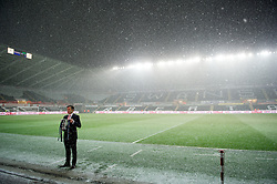 SWANSEA, WALES - Wednesday, January 23, 2013: Sky Sports' Ben Shepherd records a piece to camera in the snow before the Football League Cup Semi-Final 2nd Leg match between Swansea City and Chelsea at the Liberty Stadium. (Pic by David Rawcliffe/Propaganda)