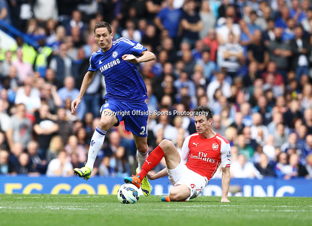 5 October 2014 - Barclays Premier League - Chelsea v Arsenal - Nemanja Matic of Chelsea in action with Laurent Koscielny of Arsenal - Photo: Marc Atkins / Offside.