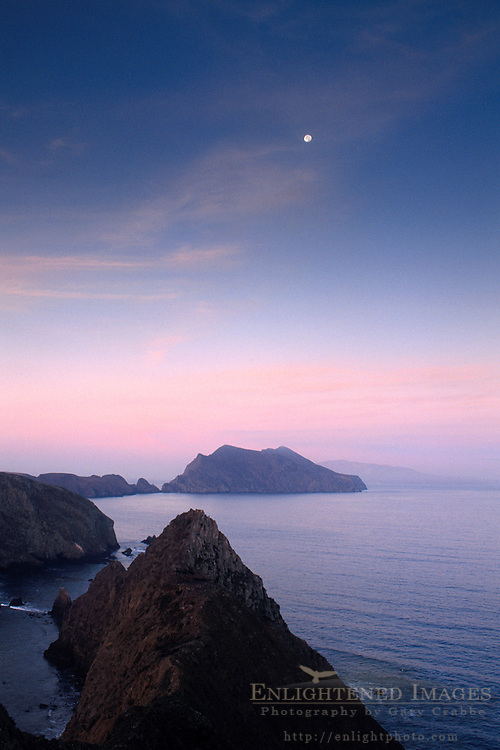 Moonset at dawn over The Pacific Ocean and Anacapa Island, from Inspiration Point, Channel Islands National Park, California