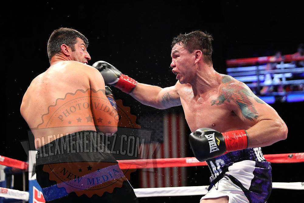 VERONA, NY - JUNE 08: Isaac Rodrigues throws a right hand to the face of Frankie Filippone during the Golden Boy on ESPN fight night at Turning Stone Resort Casino on June 8, 2018 in Verona, New York. (Photo by Alex Menendez/Getty Images) *** Local Caption *** Isaac Rodrigues; Frankie Filippone
