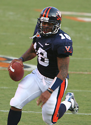 Virginia QB Marques Hagans (18) scrambles in action against WMU. The Virginia Cavaliers defeated the Western Michigan Broncos 31-19 on September 3, 2005 at Scott Stadium in Charlottesville, VA.