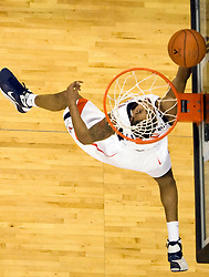 Virginia guard Sylven Landesberg (15) finishes a reverse layup against Xavier.  The #22 ranked Xavier Musketeers defeated the Virginia Cavaliers 84-70 at the John Paul Jones Arena on the Grounds of the University of Virginia in Charlottesville, VA on January 3, 2009.