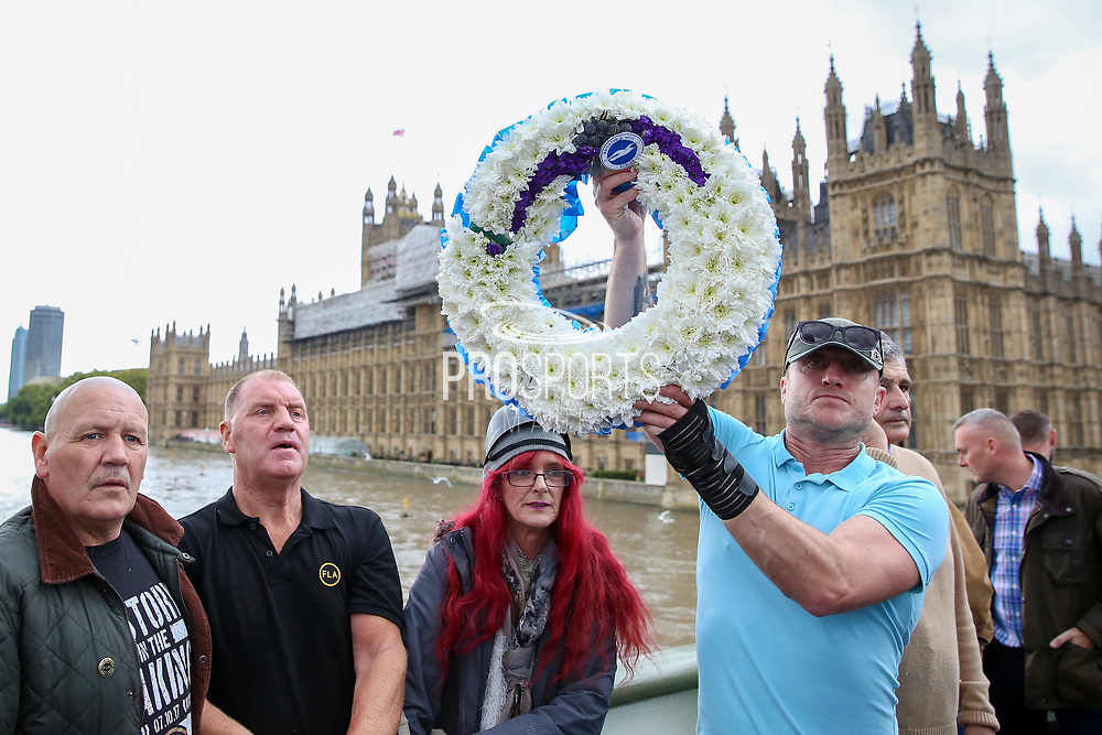 Brighton & Hove Albion FC wreath on Westminster Bridge during the Football Lads Alliance march between Park Lane and Westminster Bridge, London on 7 October 2017. Photo by Phil Duncan.