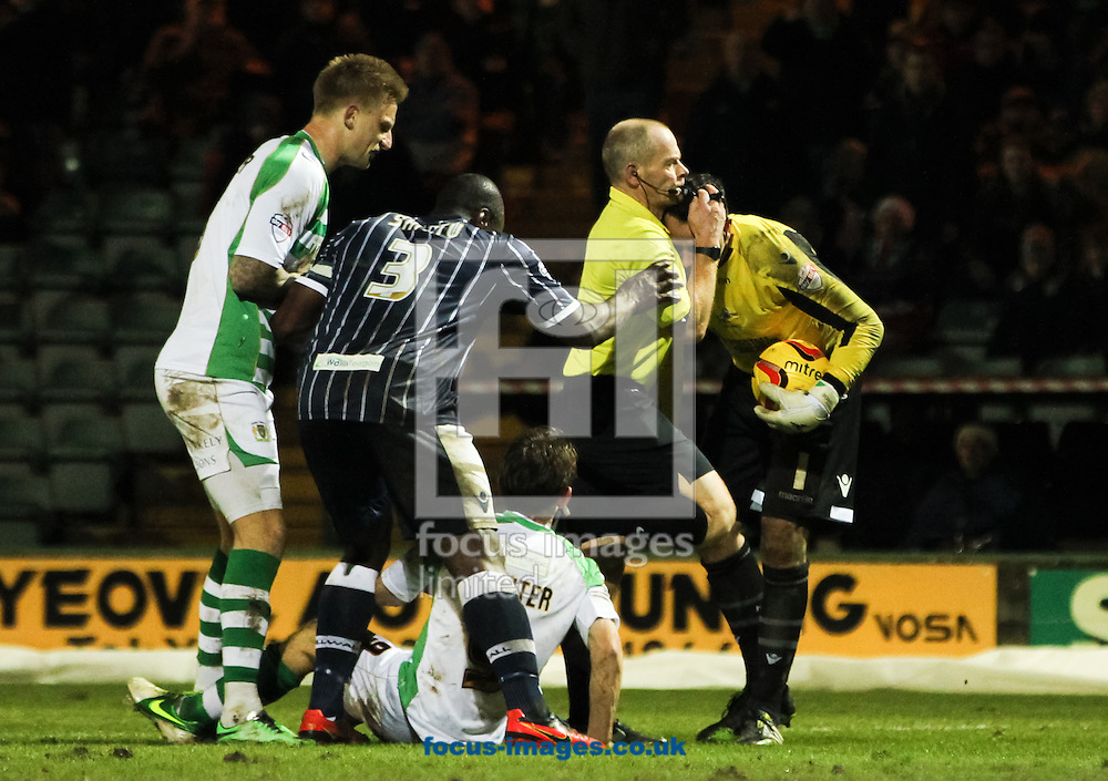 Referee Andy Woolmer (2nd right) breaks up an argument between James Hayter (centre) of Yeovil Town and David Forde (right) of Millwall during the Sky Bet Championship match at Huish Park, Yeovil<br /> Picture by Tom Smith/Focus Images Ltd 07545141164<br /> 11/02/2014