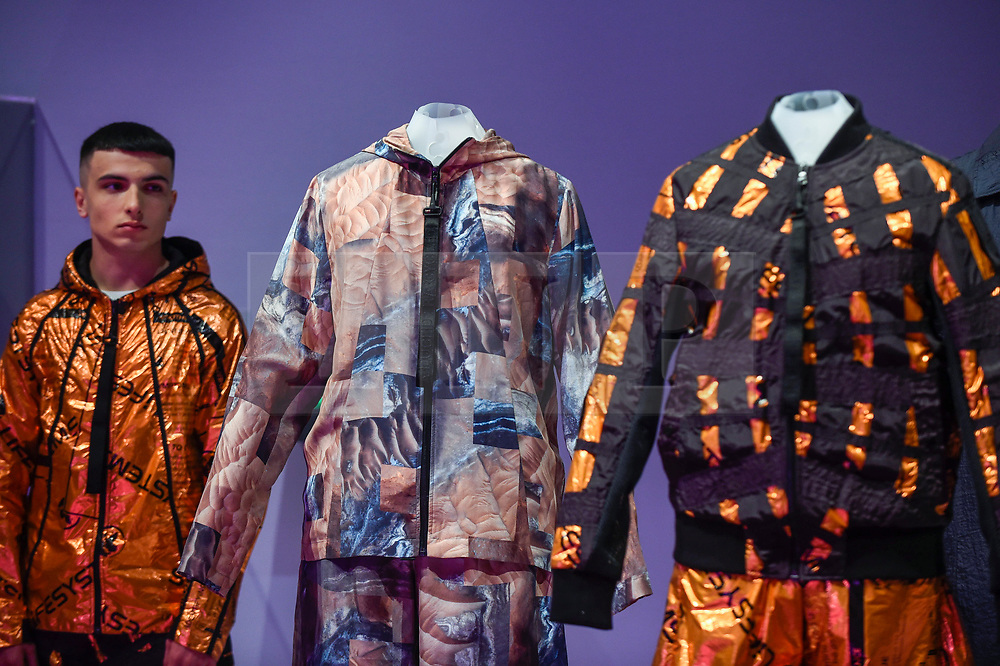 "© Licensed to London News Pictures. 17/10/2019. LONDON, UK. A model wears ""Mars clothing, SS20 New Horizons collection"", by Raeburn. Preview of ""Moving to Mars"" at the Design Museum. The exhibition explores how sending humans to Mars is a frontier for science as well as design and features over 200 exhibits from NASA, the European Space Agency together with new commissions.  The show is open 18 October to 23 February 2020.  Photo credit: Stephen Chung/LNP"