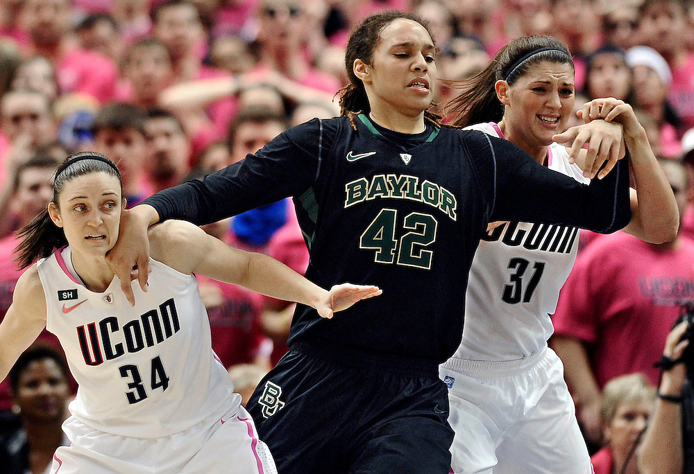 Baylor's Brittney Griner (42) fends off Connecticut's Kelly Faris (14) and Stefanie Dolson (31) during the second half of an NCAA college basketball game in Hartford, Conn., Monday, Feb. 18, 2013. Baylor won 76-70. (AP Photo/Jessica Hill)