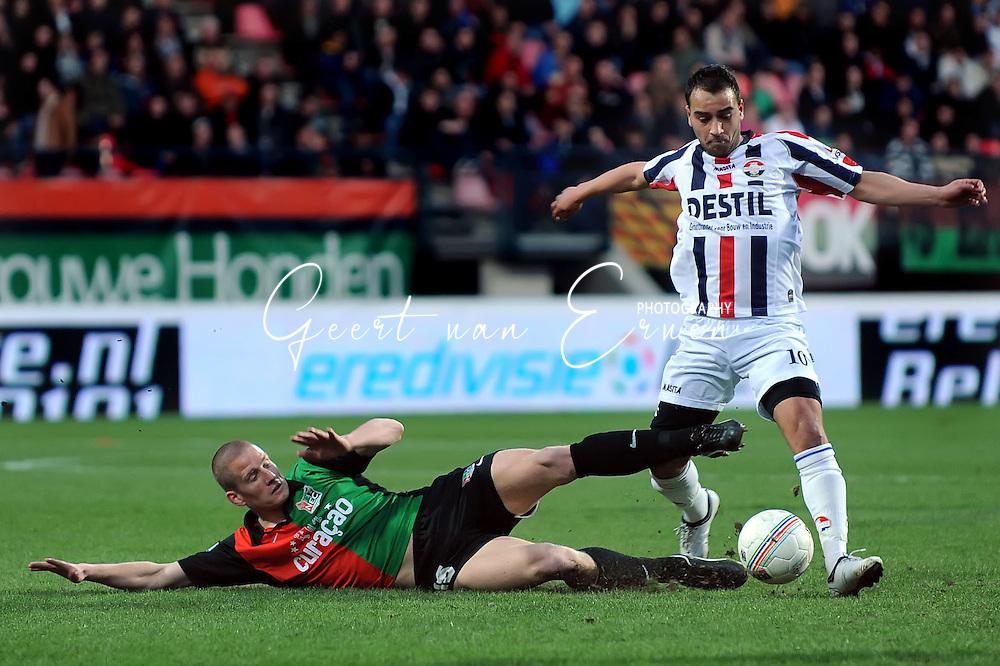 21-03-09 Voetbal:NEC Nijmegen:Willem II:Nijmegen<br /> Bas Sibum met een sliding op Said Boutahar<br /> Foto: Geert van Erven
