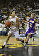 December 22 2010: Iowa guard Megan Considine (4) drives past Northern Iowa guard Rachel Madrigal (3) during the first half of an NCAA college basketball game at Carver-Hawkeye Arena in Iowa City, Iowa on December 22, 2010. Iowa defeated Northern Iowa 75-64.
