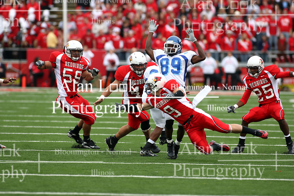 13 October 2007:  Tom Nelson makes a swipe at ball carrier Justin Collins. Collins slips behind Jeramie Gray and into the territory of Bert Whigham. The Indiana State Sycamores were jacked 69-17 by the Illinois State Redbirds at Hancock Stadium on the campus of Illinois State University in Normal Illinois.