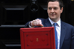 The Chancellor George Osborne leaves No11 Downing street with his red budget box for the 2014 Budget, London, United Kingdom. Wednesday, 19th March 2014. Picture by Ben Stevens / i-Images