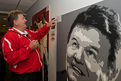 SWANSEA, WALES - Monday, March 1, 2010: Wales' manager John Toshack MBE autographs a painting before training at the Liberty Stadium ahead of the international friendly match against Sweden. (Photo by David Rawcliffe/Propaganda)