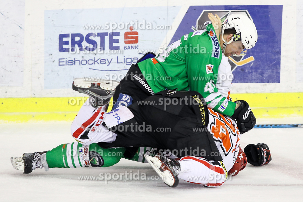Sebastjan Hadzic of Jesenice vs Sacha Guimond of Olimpija during ice hockey match between HDD Olimpija Ljubljana and HDD SIJ Acroni Jesenice in Final of Slovenian League 2016/17, on April 6, 2017 in Hala Tivoli, Ljubljana, Slovenia. Photo by Matic Klansek Velej/ Sportida