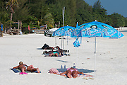Pattaya Beach. Tourists under umbrellas.
