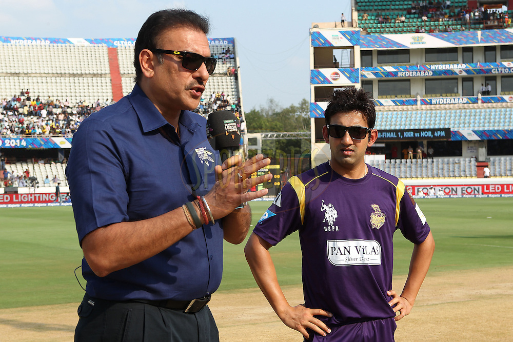 Gautam GAMBHIR (Captain) of the Kolkata Knight Riders  is interviewed by Ravi Shastri during the first semi final match of the Oppo Champions League Twenty20 between the Kolkata Knight Riders and the Hobart Hurricanes held at the Rajiv Gandhi Cricket Stadium, Hyderabad, India on the 2nd October 2014<br /> <br /> Photo by:  Ron Gaunt / Sportzpics/ CLT20<br /> <br /> <br /> Image use is subject to the terms and conditions as laid out by the BCCI/ CLT20.  The terms and conditions can be downloaded here:<br /> <br /> http://sportzpics.photoshelter.com/gallery/CLT20-Image-Terms-and-Conditions-2014/G0000IfNJn535VPU/C0000QhhKadWcjYs