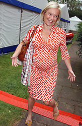 TV presenter MARIELLA FROSTRUP at the annual House of Lords v House of Commons tug of war match in aid of  of  Macmillan Cancer Relief on 22nd June 2004.  A drinks reception was held in College Gardens followd by the tug of war on Victoria Tower Gardens, London.