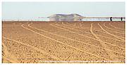 Bayuda Desert, Sudan-- June 20, 2004    Tire tracks criss cross the Bayuda Desert as a mirage in the horizon tricks the traveler into believing the presence of water.(Essdras M Suarez/ Globe Staff)