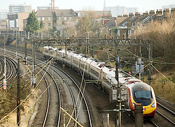 © under license to London News Pictures.  02/01/2011. A Train passing through Kensal Green, North West London today (02/01/2010). Rail fares are due to rise today (02/01/2010) with some fares due to go up up almost 13%. Overall, main line fares are rising by an average of 6.2%, with regulated fares, which include season tickets, going up by average of 5.8%. Photo credit should read Sam Long/ London News Pictures