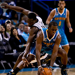 October 9, 2010; New Orleans, LA, USA; New Orleans Hornets point guard Chris Paul (3) battles Memphis Grizzlies shooting guard Tony Allen (9) for a loose ball during the second quarter of a preseason game at the New Orleans Arena. Mandatory Credit: Derick E. Hingle