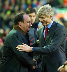 LIVERPOOL, ENGLAND - Sunday, December 13, 2009: Liverpool's manager Rafael Benitez and Arsenal's manager Arsene Wenger during the Premiership match at Anfield. (Photo by: David Rawcliffe/Propaganda)
