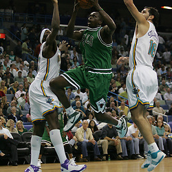 Bulls forward Luol Deng #9 slices through the lane between Hornets defenders Peja Stojakovic (R) and Julian Wright (L) during the first half of their NBA game against the New Orleans Hornets on March 17, 2008 at the New Orleans Arena in New Orleans, Louisiana. The New Orleans Hornets defeated the Chicago Bulls 108-97.