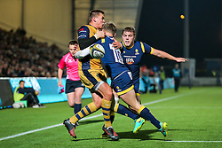 Gareth Maule of Bristol Rugby is tackled by Jamie Shillcock of Worcester Warriors - Rogan Thomson/JMP - 04/11/2016 - RUGBY UNION - Sixways Stadium - Worcester, England - Worcester Warriors v Bristol Rugby - The Anglo Welsh Cup.