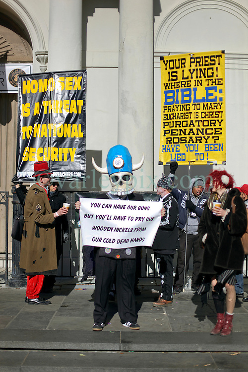 09 February 2016. New Orleans, Louisiana.<br /> Mardi Gras Day. Walking with Skeletons. Members of the Skeleton Krewe address rude and abusive fundamentalist Christians spewing their messages of hate at St Louis Cathedral. <br /> Photo©; Charlie Varley/varleypix.com
