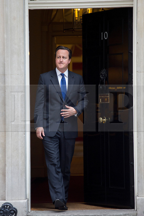 © licensed to London News Pictures. London, UK 08/10/2013. Prime Minister David Cameron waiting for President of the European Council Herman Van Rompuy in Downing Street on Tuesday, 8 October 2013. Photo credit: Tolga Akmen/LNP
