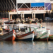 Small wooden fishing boats on the waterfront of Panama City, Panama, on Panama Bay.