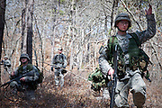 Apr, 10, 2011, Camp Edwards, Massachusetts - Cadet Jon Broderick signals to other ROTC cadets to begin to move forward during a patrolling exercise at spring field training. Photo by ©Lathan Goumas.