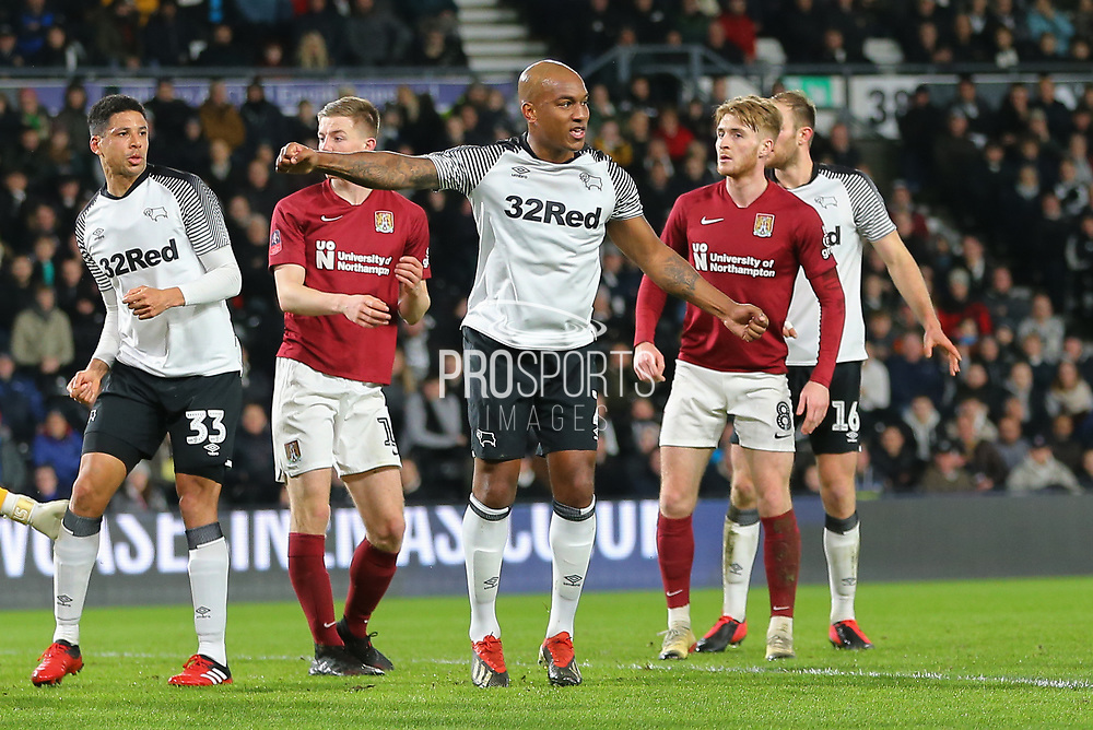 Derby County defender Andre Wisdom (2) turns and celebrates after scoring during the The FA Cup match between Derby County and Northampton Town at the Pride Park, Derby, England on 4 February 2020.