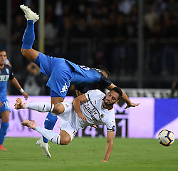 EMPOLI, Sept. 28, 2018  AC Milan's Hakan Calhanoglu (R) vies with Empoli's Antonino La Gumina during a Serie A soccer match between AC Milan and Empoli in Empoli, Italy, Sept. 27, 2018. The match ended in a 1-1 draw. (Credit Image: © Alberto Lingria/Xinhua via ZUMA Wire)
