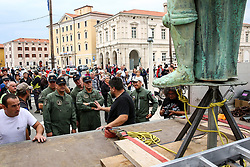 After two months of restoration, the Statue of Archangel Michael, made of copper plate, returned to Piran. The image shows Joze Dresar (Gnom) talking with officers of the 151st Rotary Wing Squadron before helicopter placing it on top of the church's clock, on October 15, 2018 in Piran, Slovenia. Photo by Matic Klansek Velej / Sportida