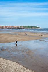 Holiday makers on the flat Beach during the May Bank Holiday. Filey, North Yorkshire<br />  <br /> 21 May 2013<br /> Image © Paul David Drabble<br /> www.pauldaviddrabble.co.uk